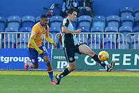 Wycombe Wanderers Luke O'Nien plays the ball forward tracked by Mansfield Town's Reggie Lambe during the Sky Bet League 2 match between Mansfield Town and Wycombe Wanderers at the One Call Stadium, Mansfield, England on 31 October 2015. Photo by Garry Griffiths.
