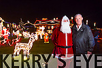 Santa and Tony Noonan at the official turning on of the Tony Noonan charity Christmas lights in Templeglantine on Friday night.