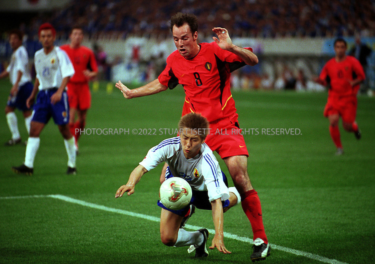 6/4/2002--Saitama, Japan..Bart Goor of Belguim wrestles with Kazuyuki Toda as he attempts to score against Japan during the 1st half of a 2002 World Cup Group H match Japan vs Belgium in Saitama, Japan. The match ended 2-2. The other teams playing in Group H are Russia and Tunisia. ...All photographs ©2003 Stuart Isett.All rights reserved.This image may not be reproduced without expressed written permission from Stuart Isett.