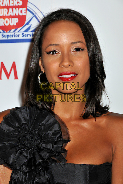 DANIA RAMIREZ.9th Annual Padres Contra El Cancer Benefit Gala held at the Hollywood Palladium, Hollywood, California, USA..September 10th, 2009.headshot portrait red lipstick black hoop earring beauty corsage one shoulder strapless .CAP/ADM/BP.©Byron Purvis/AdMedia/Capital Pictures.