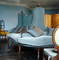 This unusual banquette sofa in duck-egg blue can be found in a lounge of the Grove Hotel in Hertfordshire and is designed by Martin Hulbert