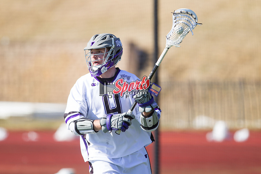Dan Lomas (4) of the High Point Panthers controls the ball against the St. Joseph's Hawks at Vert Track, Soccer & Lacrosse Stadium on February 16, 2014 in High Point, North Carolina.  The Panthers defeated the Hawks 9-7.   (Brian Westerholt/Sports On Film)
