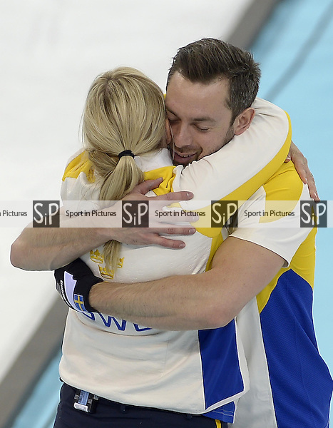 Swedish coach Eva Lund celebrates with Niklas Edin (SWE, skip).  (SWE). Mens curling - Bronze medal match - SWE v CHN - Ice Cube Curling Centre - Olympic Park - PHOTO: Mandatory by-line: Garry Bowden/SIPPA/Pinnacle - Photo Agency UK Tel: +44(0)1363 881025 - Mobile:0797 1270 681 - VAT Reg No: 768 6958 48 - 210214 - 2014 SOCHI WINTER OLYMPICS - Ice Cube Curling Centre, Sochi, Russia