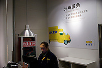 A clerk manages shipping orders at the delivery station inside a new Ikea store in Nanjing, Jiangsu, China.