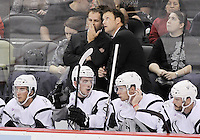 San Antonio assistant coach Jason Cipolla, left, whispers to head coach Chuck Weber during the second period of an AHL hockey game, Saturday, Oct. 13, 2012, in San Antonio. Texas won 2-1. (Darren Abate/pressphotointl.com)