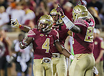 Calvin Cook, left, Tyler Hunter, second from left, and Marvin Saunders celebrate as time runs out of an NCAA college football game against Miami in Tallahassee, Fla., Saturday, Oct. 10, 2015.   The Florida State Seminoles defeated the Miami Hurricanes 29-24.