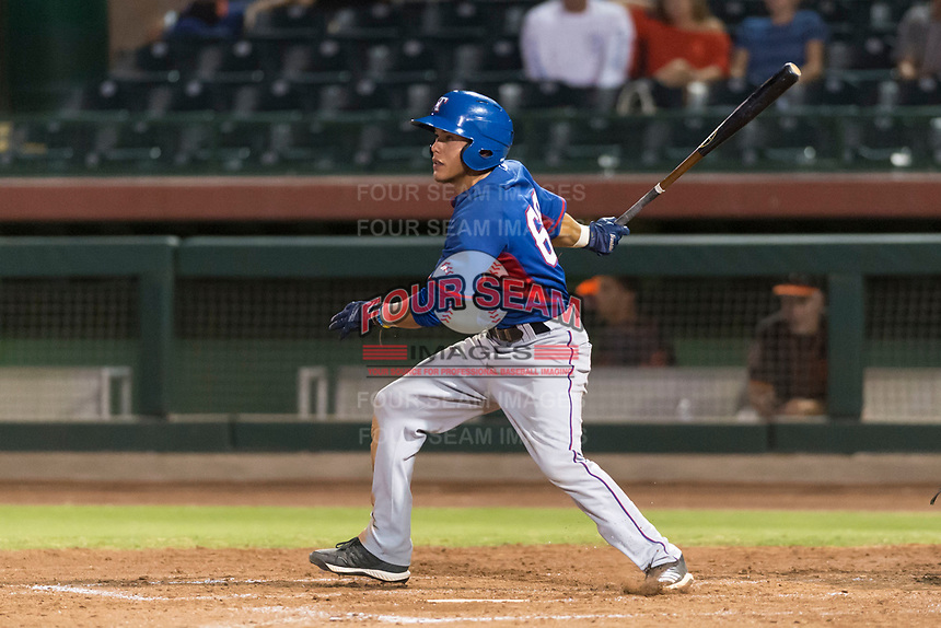 AZL Rangers third baseman Frainyer Chavez (60) follows through on his swing during an Arizona League game against the AZL Giants Black at Scottsdale Stadium on August 4, 2018 in Scottsdale, Arizona. The AZL Giants Black defeated the AZL Rangers by a score of 6-3 in the second game of a doubleheader. (Zachary Lucy/Four Seam Images)