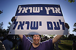 A Israeli right-wing activist holds a sign during a protest that was held outside the USA consulate in Jerusalem against hardline USA stance, Wednesday, June 3, 2009. The demonstration was held on the eve of USA president Barak Obama's much anticipated address to the Muslim world in Cairo. Photo By: Emil Salman / JINI