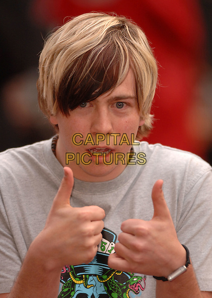 "JAMES BOURNE.""Mission Impossible 3"" UK Film Premiere - Arrivals,.Odeon Leicester Square, London, England,.April 25th 2006.  .Mission: Impossible III portrait headshot funny thumbs up gesture dyed hair busted son of dork.Ref: FIN.www.capitalpictures.com.sales@capitalpictures.com.©Steve Finn/Capital Pictures."
