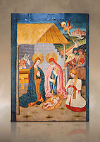 Gothic altarpiece ofthe Nativity from the workshop of Taller de Pere Garcia de Benavarri, circa 1475, tempera and gold leaf on for wood, from the church of Nostra Senyora de Baldos de Montanyana, Osca.  National Museum of Catalan Art, Barcelona, Spain, inv no: MNAC   114750-1. Against a art background.