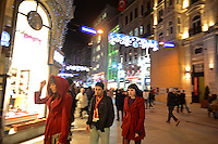 Women are seen wearing bright red coats on Istiklal Caddesi in Beyoglu, Istanbul, Turkey on December 5, 2012.