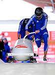 18 December 2010: Alexey Gorlachev starts up his 2-man bobsled for Russia, finishing in 11th place at the Viessmann FIBT World Cup Bobsled Championships on Mount Van Hoevenberg in Lake Placid, New York, USA. Mandatory Credit: Ed Wolfstein Photo