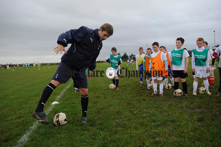 Coach Joe Staunton shows young Clare soccer hopefuls the ropes during the visit of the Tottenham Hotspurs Training Academy to Mullagh to coach and select players to take to the club. Photograph by John Kelly.