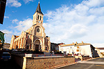 The Wine Route in early spring in Beaujolais, France. The village of Julienas, one of the ten crus of Beaujolais.  The church in the city center.