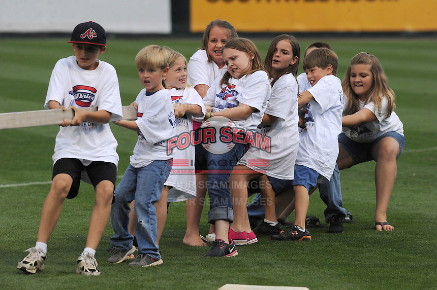 Young fans of the Greenville Drive strain as they play a game of tug-of-war in between innings of a game against the Asheville Tourists on May 14, 2012, at Fluor Field at the West End in Greenville, South Carolina. Asheville won 11-6. (Tom Priddy/Four Seam Images)