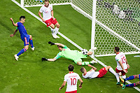 KAZAN, RUSSIA - June 24, 2018: Poland goalkeeper Wojciech Szczesny stops a shot  against Colombia in their 2018 FIFA World Cup group stage match at Kazan Arena.