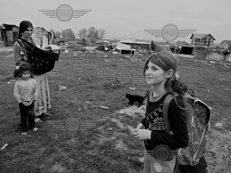 Mother of nine Samia Seferovic (left), with children who have just returned from school, and others who have stayed at their home in a Roma camp in Sarajevo, Bosnia-Herzegovina on October 23, 2008. Many Roma children don't attend school because they have to work, are bullied in school, or due to their parents being sceptical of public education..The Roma population in Bosnia-Herzegovina was heavily affected by the wars in the former Yugoslavia in the early 1990's. It is now estimated at 100,000, but there are no accurate figures, as many are not registered anywhere, either as a result of their own scepticism towards authorities, or due to difficulties in dealing with bureaucratic rules and procedures. Many Roma have no passports, no birth certificates and most importantly, no health insurance. Some aspects of their traditions, culture and lifestyle clash with accepted norms here, as happens elsewhere in Europe. As a result most Roma in the Balkans live in poverty.