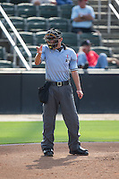 Home plate umpire Reid Joyner makes a strike call during the South Atlantic League game between the Hagerstown Suns and the Kannapolis Intimidators at CMC-Northeast Stadium on August 16, 2015 in Kannapolis, North Carolina.  The Suns defeated the Intimidators 7-2 in game one of a double-header.  (Brian Westerholt/Four Seam Images)