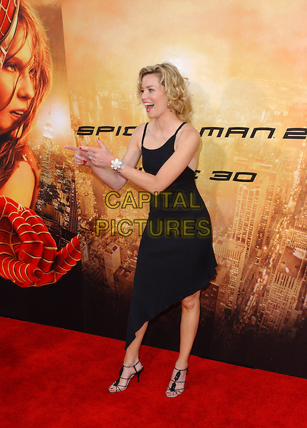 ELIZABETH BANKS .Columbia Pictures' World Premiere of Spider-Man 2 held at The Mann Village Theatre in Westwood, .California, .June 22nd 2004..full length full-length little black dress pointing fingers gesture funny aysemetric hem strappy heels shoes spiderman.Copyright 2004 by Debbie VanStory.*UK sales only*.www.capitalpictures.com.sales@capitalpictures.com.©Capital Pictures
