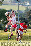 An Ghaeltacht  Ciaran Ó Coileain and Roibeard Ó Sé in a piece of fielding, closely watched by Daingean Uí Chúis Eoin Ó Murchú during the Senior County Football League round 1 game at Pairc an Aghasaigh, Dingle, on Saturday evening.
