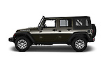 Car Driver side profile view of a 2016 JEEP Wrangler-Unlimited Rubicon 5 Door SUV Side View