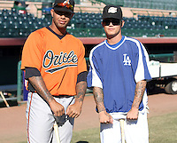 Josh Bell (Phoenix Desert Dogs) and Justin Sellers (Peoria Javelinas) show off their tattoos before the Arizona Fall League championship game. The Peoria Javelinas won the AFL championship over the Phoenix Desert Dogs, 5-4, at Scottsdale Stadium, Scottsdale, AZ (11/21/2009). .Photo by:  Bill Mitchell/Four Seam Images..