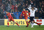 Gareth Bale scores the winner for Wales as Jamie Mackie is dejected