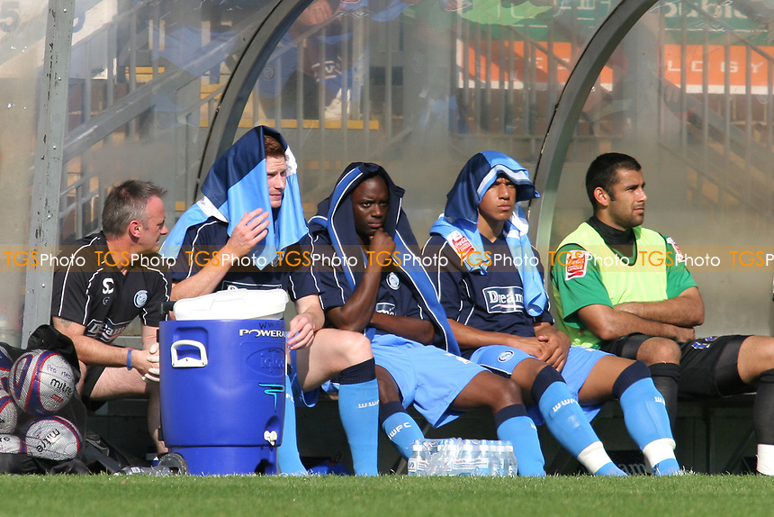 Wycombe Wanderers substitutes from left to right, Matt Harrold, Nathan Ashton and Matt Phillips try to cool down and avoid the direct sunlight as they put their shirts or tracksuit on their heads for shelter against the sun during Wycombe Wanderers vs Dagenham & Redbridge, Coca Cola League Division Two Football at Adams Park on 20th September 2008