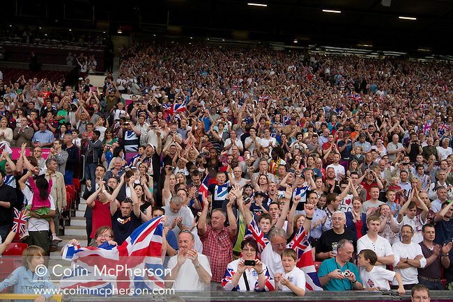 Supporters of the Great Britain football cheering as the match is about to kick-off at Manchester United's Old Trafford stadium prior to their team's Men's Olympic Football tournament match at the venue. The double header of matches resulted in Uruguay defeating the United Arab Emirates by 2-1 while Great Britain and Senegal drew 1-1. Over 72,000 spectators attended the two Group A matches.