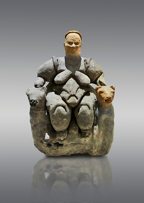 Terracotta Goddess figure which has been associated with agriculture & human fertility because of her big breasts and wide hips. She is depicted sitting between 2 leopards suggesting she was important. 5750 BC. . Catalhoyuk Collections. Museum of Anatolian Civilisations, Ankara. Against a grey background