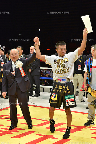 (L-R) Yuko Hayashi, Takashi Uchiyama (JPN),<br /> DECEMBER 31, 2013 - Boxing :<br /> Takashi Uchiyama of Japan celebrates with Japan Boxing Commission (JBC) Commissioner Yuko Hayashi after winning the WBA super featherweight title bout at Ota-City General Gymnasium in Tokyo, Japan. (Photo by Hiroaki Yamaguchi/AFLO)