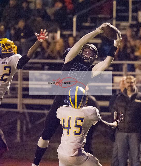 Chugiak's Derryk Snell catches a touchdown pass as Bartlett's Drayton Ingram and Damarian Garrett defend. Photo for the Star by Michael Dinneen