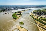 Nederland, Gelderland, Nijmegen, 09-06-2016; verlengde Waalbrug kruist de de nieuw aangelegde nevengeul van de rivier de Waal, ontstaan door de dijkverlegging bij Lent. Onderdeel van het project Ruimte voor de River (Ruimte voor de Waal). Op de landtong het stadseiland Veur-Lent, links de binnenstad van Nijmegen, rechts de ingang van de nevengeul met drempel.<br /> The finished dike relocation of Lent (project Ruimte voor de Rivier: Room for the River) with the resulting flood trench. Entrance to the secondary channel with the threshold. In the background the city of Nijmegen.<br /> luchtfoto (toeslag op standard tarieven);<br /> aerial photo (additional fee required);<br /> copyright foto/photo Siebe Swart