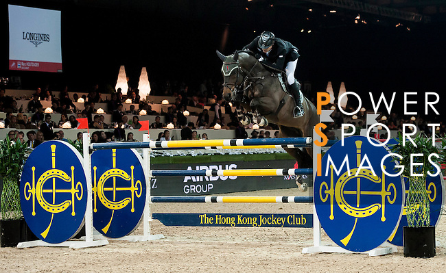 Marc Houtzager of Netherlands rides Baccarat at the Longines Grand Prix during the Longines Hong Kong Masters 2015 at the AsiaWorld Expo on 15 February 2015 in Hong Kong, China. Photo by Xaume Olleros / Power Sport Images