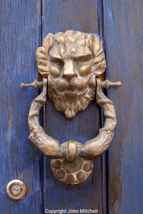 Lion door knocker, San Miguel de Allende, Mexico. San Miguel de Allende is a UNESCO World Heritage Site....