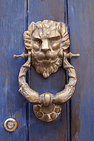 Lion door knocker, San Miguel de Allende, Mexico. San Miguel de Allende is a UNESCO World Heritage Site....
