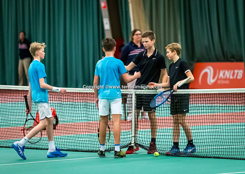 Wateringen, The Netherlands, December 15,  2019, De Rhijenhof , NOJK juniors doubles , Final boys 12 years :  Thijs Boogaard (NED) Sander Paradis (NED) (L) congratulate  Mees Röttgering (NED) and Hidde Schoenmakers (NED) with their win.<br /> Photo: www.tennisimages.com/Henk Koster