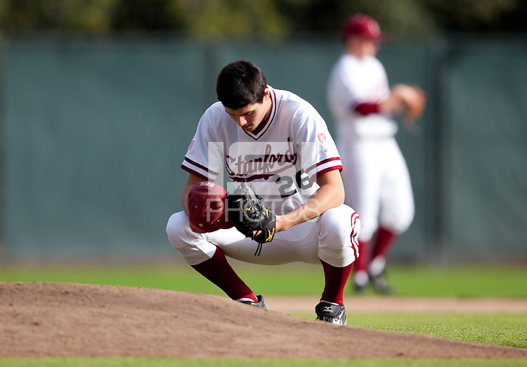 STANFORD, CA - March 25, 2011: Mark Appel of Stanford baseball bows his head before pitching in Stanford's game against Long Beach State at Sunken Diamond. Stanford lost 6-3.