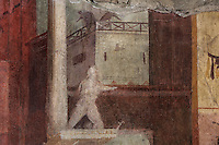Fresco of a man with a background of buildings painted using perspective, in the frigidarium or cold pool of the bathhouse of the Casa del Criptoportico, or House of the Cryptoporticus, Pompeii, Italy. This room is decorated in the Second Style of Pompeiian wall painting, 1st century BC. The house is one of the largest in Pompeii and was owned by the Valerii Rufi family and built in the 3rd century BC. It takes its name from the underground corridor used as a wine cellar and lit by small windows. Pompeii is a Roman town which was destroyed and buried under 4-6 m of volcanic ash in the eruption of Mount Vesuvius in 79 AD. Buildings and artefacts were preserved in the ash and have been excavated and restored. Pompeii is listed as a UNESCO World Heritage Site. Picture by Manuel Cohen