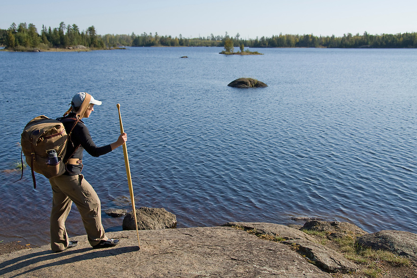 A canoeist carries a pack and a paddle in the Boundary Waters Canoe Area Wilderness in Northern Minnesota.