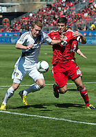 30 March 2013: Los Angeles Galaxy forward Jack McBean #32 and Toronto FC defender Darren O'Dea #48 in action during an MLS game between the LA Galaxy and Toronto FC at BMO Field in Toronto, Ontario Canada..The game ended in a 2-2 draw..