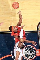 Syracuse forward C.J. Fair (5) shoots over Virginia forward Akil Mitchell (25) during an NCAA basketball game Saturday March 1, 2014 in Charlottesville, VA. Virginia defeated Syracuse 75-56.