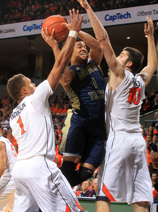 Georgia Tech guard Tadric Jackson (1) tries to shoot between Virginia guard Justin Anderson (1) and Virginia forward/center Mike Tobey (10) during an NCAA basketball game Thursday Jan. 22, 2015, in Charlottesville, Va. (Photo/Andrew Shurtleff)