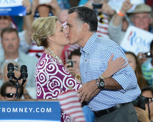 PORT ST. LUCIE, FL - OCTOBER 07: Republican presidential candidate, former Massachusetts Gov. Mitt Romney and his wife Ann Romney kiss during a rally at Tradition Town Square on October 7, 2012 in Port St. Lucie, Florida. ©mpi04/MediaPunch Inc.