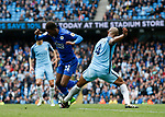 Vincent Kompany of Manchester City executes a perfect tackle on Demarai Gray of Leicester City in the last minute during the English Premier League match at the Etihad Stadium, Manchester. Picture date: May 13th 2017. Pic credit should read: Simon Bellis/Sportimage