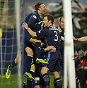 Dundee's Jim McAlister (hidden) is congratulated after the first goal.