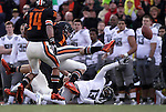 12/04/10-- Oregon's Cliff Harrris fumbles the ball during a kickoff return in the first quarter during the Civil War game at Reser Stadium in Corvallis, Or..Photo by Jaime Valdez......