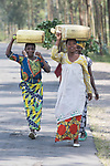 Women Carrying Containers On Thier Heads