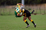 The only way is down for C. Anderson as he is tackled by E. Poa. Counties Manukau Premier Club Rugby, Drury vs Bombay played at the Drury Domain, on the 14th of April 2006. Bombay won 34 - 13.