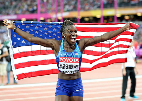 August 12th 2017, London Stadium, East London, England; IAAF World Championships, Day 9; Dawn Harper Nelson of USA holds up the flag of USA after finishing in 2nd place in the 100 metres hurdles women final in celebration